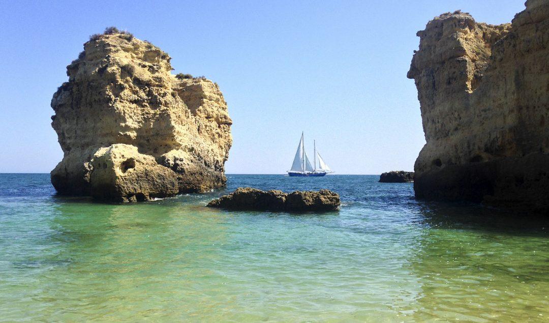 sea-sun-boat-cliff